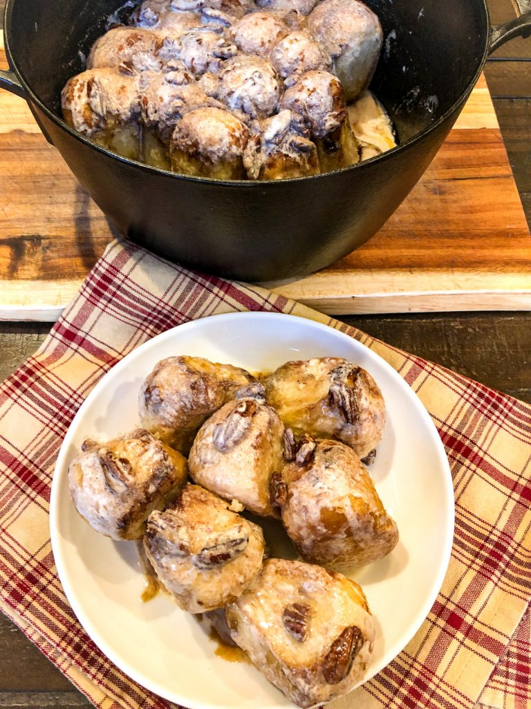 Dutch Oven Cinnamon Rolls plated and in the DO still; ready to eat.