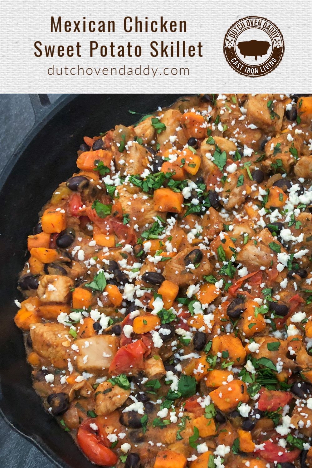 Mexican inspired skillet dinner with chicken, sweet potatoes, black beans, tomatoes, garnished with cilantro and queso fresco.