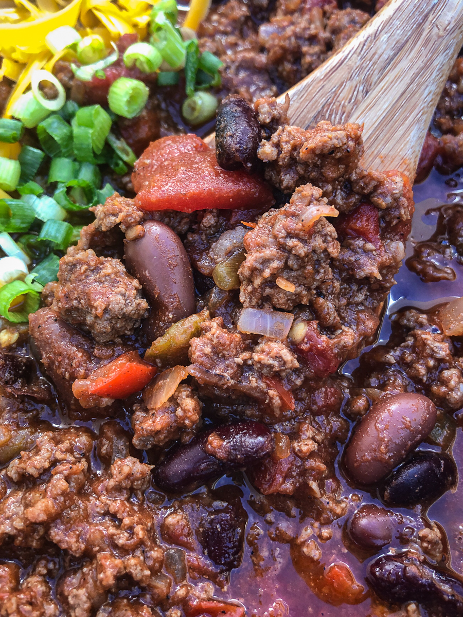 Super close up of a spoonful of dutch oven awesome chili.