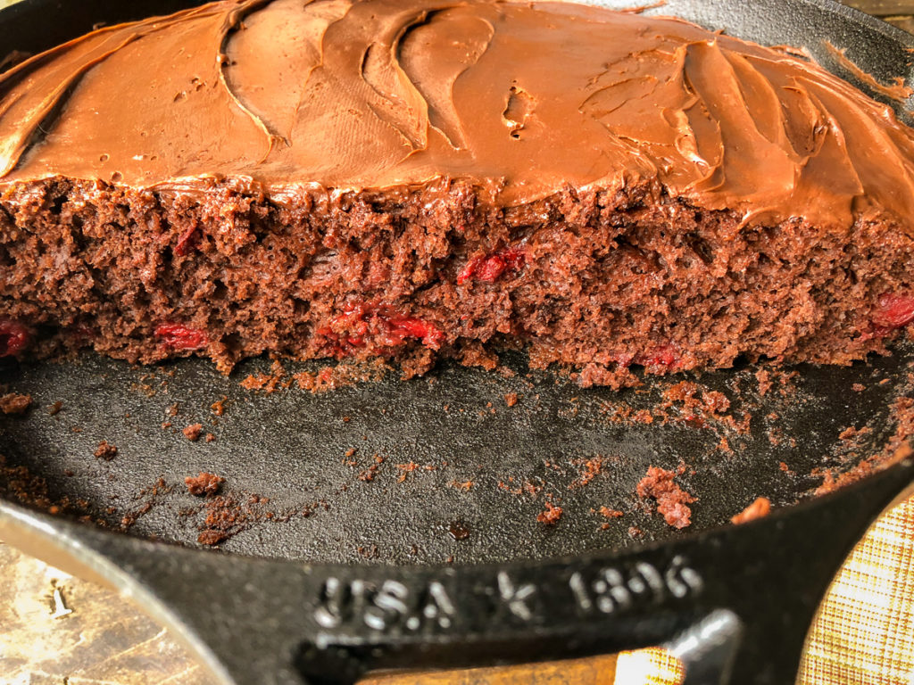 Inside and side view of the chocolate cherry cake in the skillet.