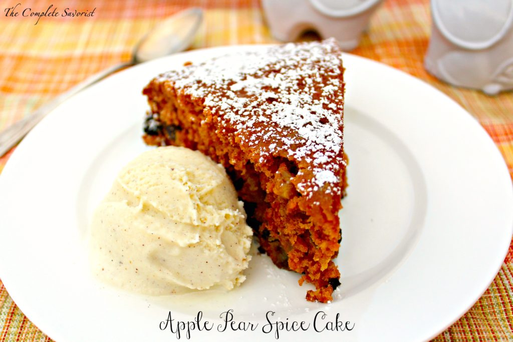 Slice of skillet apple pear spice cake with a scoop of vanilla bean ice cream.