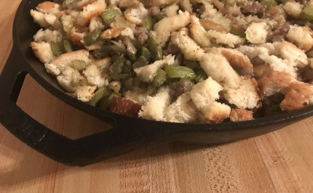 Original December 11, 2017 image of Skillet sausage stuffing on a wood cutting board background.