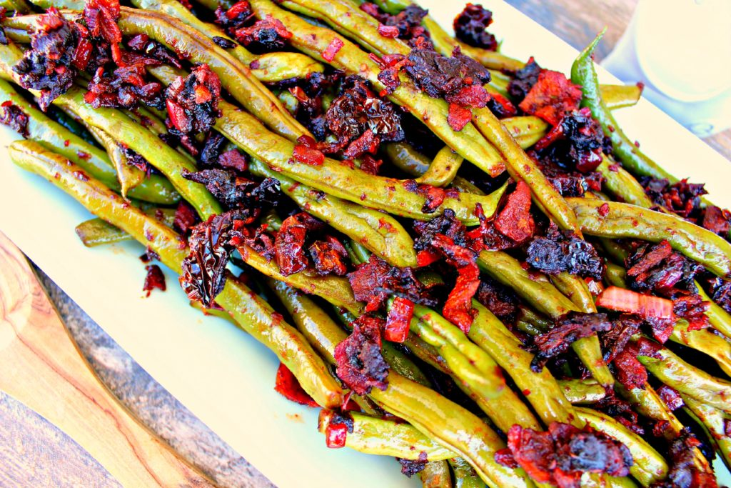 Fresh green beans tossed with bacon and sun-dried tomatoes.