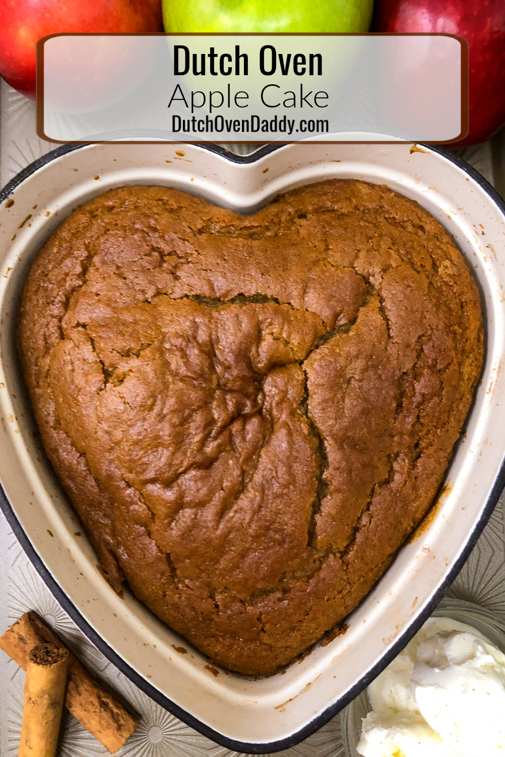 Freshly baked apple cake in a heart-shaped enamel dutch oven