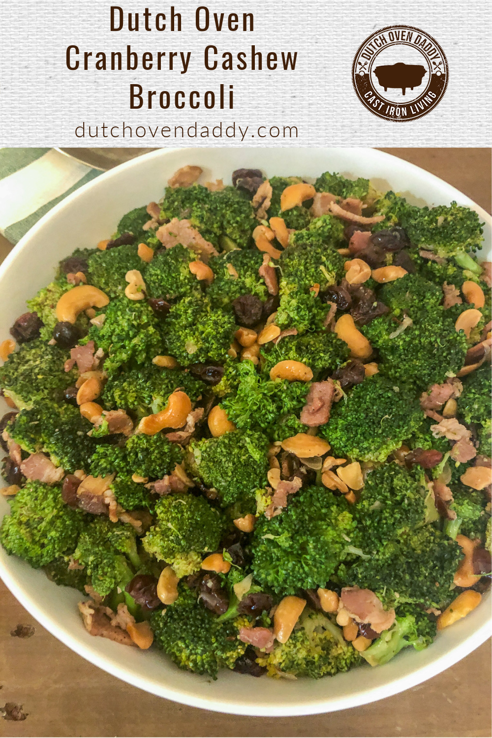 Sautéed broccoli, cashews, cranberries, bacon, and onions in a white bowl.