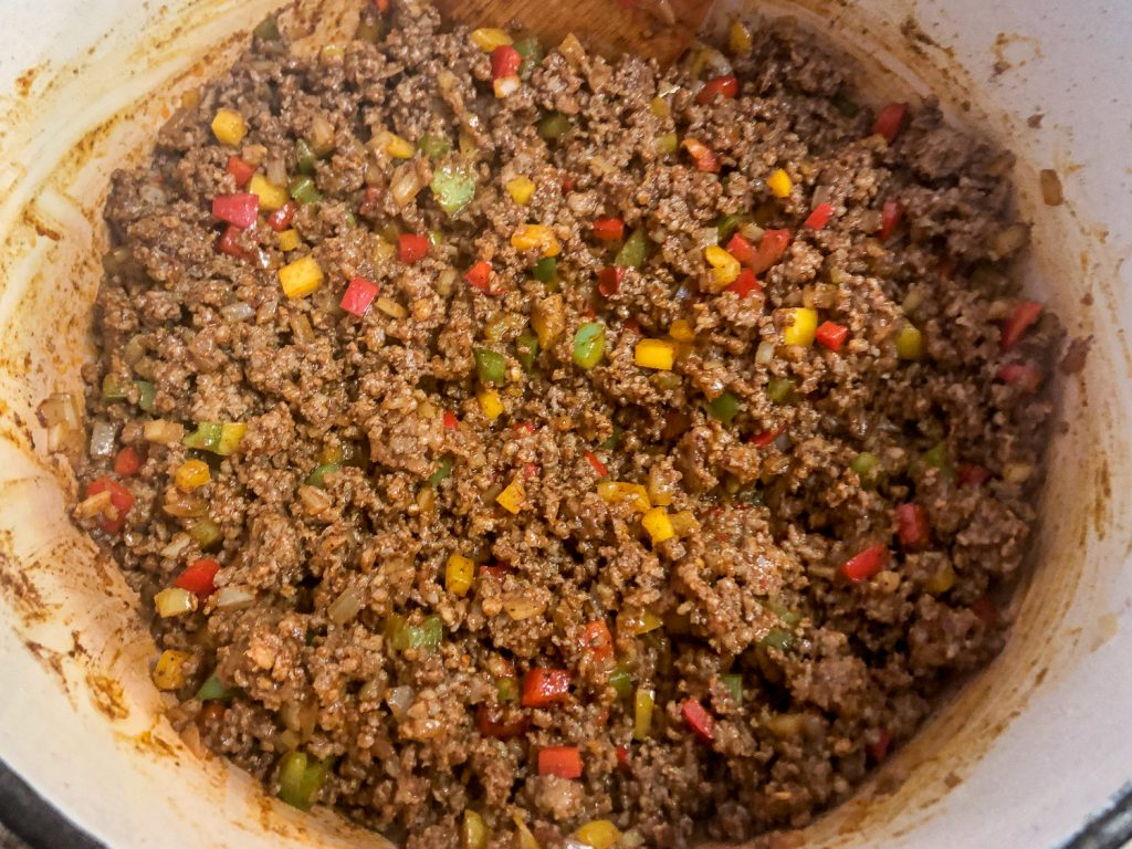 The spices have fully been incorporated to the meat mixture.