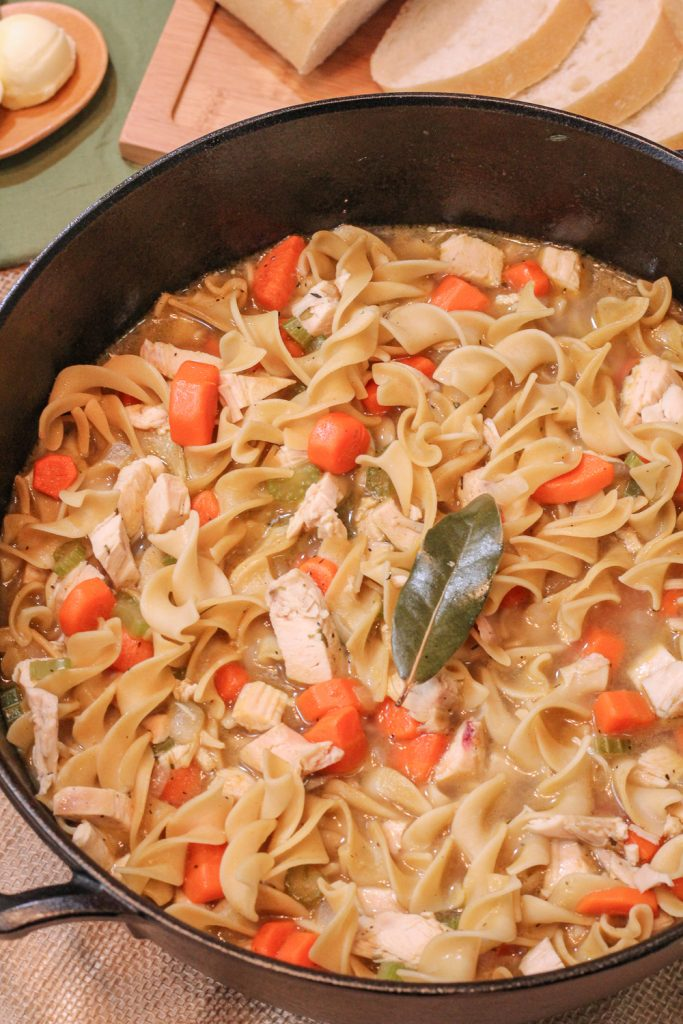 Close up side angle view of Chicken Noodle Soup in the Dutch oven.